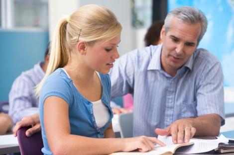 teacher-with-high-school-student